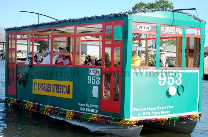 "A boat float is decorated as a street car to represent the theme of ""The Big Easy"" during the Krewe of Bilge parade in Slidell on Saturday, February 15, 2014."