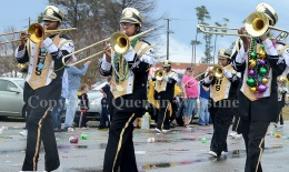 Trombone players in the Bogalusa High School band perfrom during the Krewe of Dionysus parade in Slidell on Sunday, February 23, 2014.