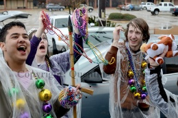 Parade goers catch beads and toys during the Krewe of Dionysus parade in Slidell on Sunday, February 23, 2014.