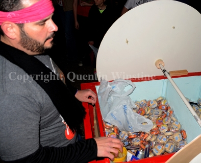 A member of the Krewe of Mona Lisa and MoonPie has a cart full of moonpies to throw to the crowd during the krewe's parade in Slidell on Saturday, February 15, 2014.