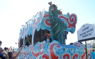 The officers of the Krewe of Perseus float during the krewe's parade in Slidell on Sunday, February 16, 2014.