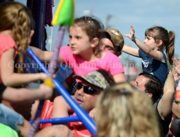 Many parents put their young children on their shoulders to help them catch beads during Krewe of Perseus parade in Slidell on Sunday, February 16, 2014.