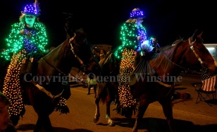 Two members of a horse riding group hand out beads during the Krewe of Selene parade in Slidell on Friday, February 28, 2014.