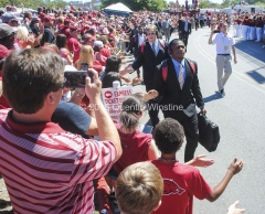 Quentin Winstine Arkansas Razorback football players shake hands and high five with fans during the Hog Walk before the game against the Toledo Rockets at War Memorial Stadium in Little Rock on Saturday, September 12, 2015.