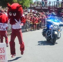 Quentin Winstine Big Red runs past the crowd of fans during the Hog Walk before the Arkansas Razorbacks game against the Toledo Rockets at War Memorial Stadium in Little Rock on Saturday, September 12, 2015.