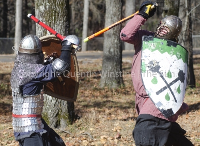 Quentin Winstine | The Sun Blake Brown, left, defends himself from an attack by Steve Williams, right, as they spare on Saturday, Dec. 1, 2018, at Craighead Forest Park. Brown and Williams are both members of the Society for Creative Anachronism which is an organization whose members enjoy recreating Middle Ages items and fighting techniques.