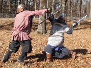 Quentin Winstine | The Sun Steve Williams, left, and Henry Carroll, right, spare against each other durnig a meet-up of members from the Society of Creative Anachronism, Dagorhir Battle Games, and Amtgard on Saturday, Dec. 1, 2018, at Craighead Forest Park.