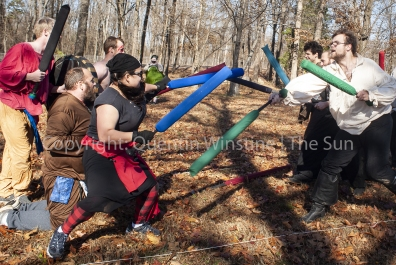 Quentin Winstine | The Sun Members of the Dagorhir Battle Games and Amtgard compete in a bridge battle contest durnig a meet-up of members from the Society of Creative Anachronism, Dagorhir Battle Games, and Amtgard on Saturday, Dec. 1, 2018, at Craighead Forest Park.